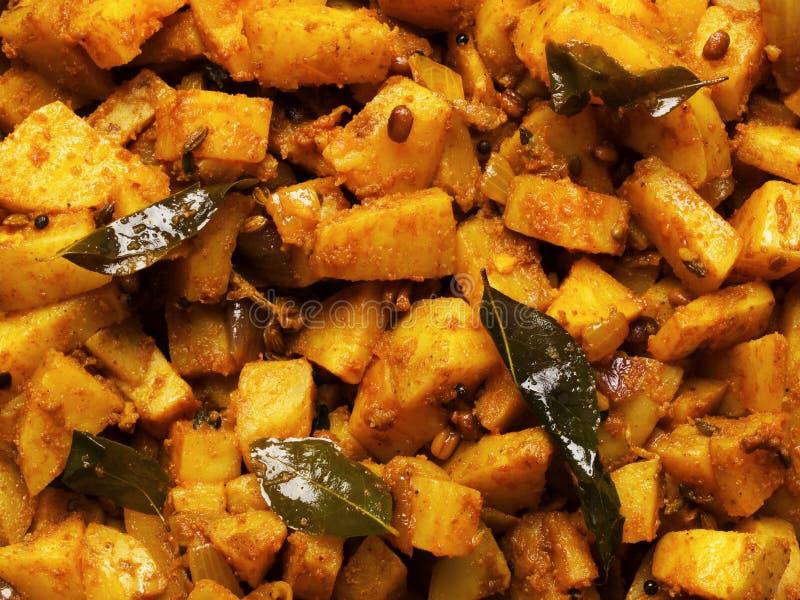Pommes de terre épicées de cari photo stock