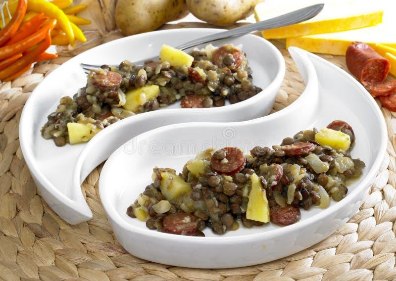 pommes de terre de lentille photographie stock libre de droits