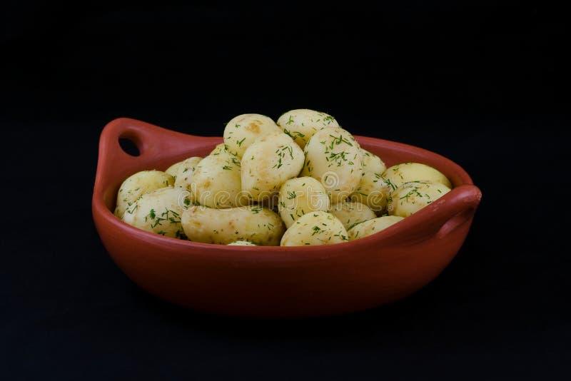 Pommes de terre de primeurs cuites image stock
