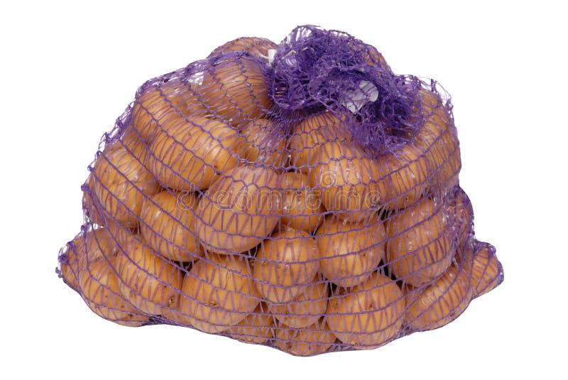 Pommes de terre en emballage net image stock
