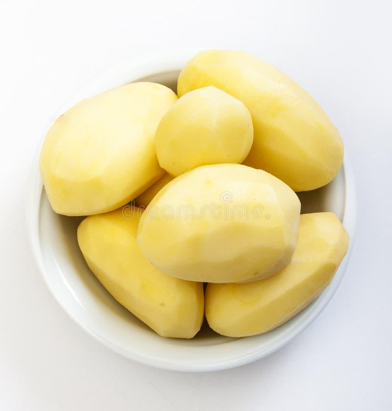 Pommes de terre enlevées crues images libres de droits