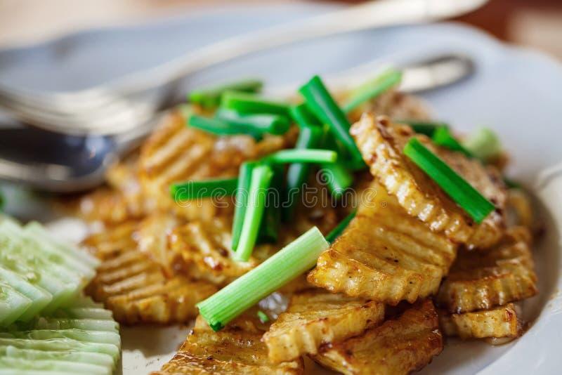 Pommes de terre frites aux oignons photo stock