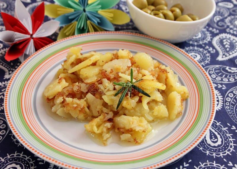 Pommes de terre frites aux oignons image stock