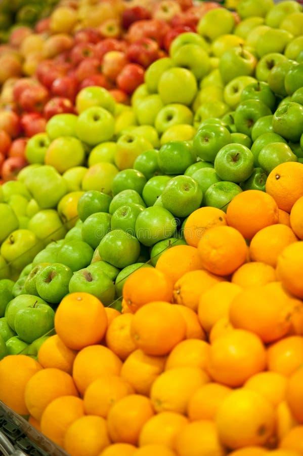 Pommes et oranges images libres de droits