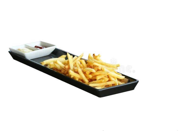 Pommes frites avec le ketchup du plat noir photographie stock libre de droits