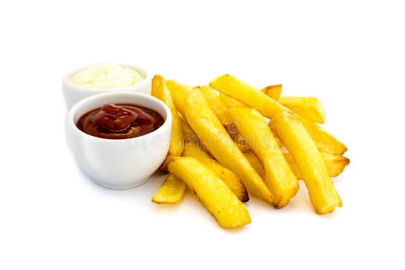 Pommes frites avec le ketchup et la mayonnaise d'isolement sur le fond blanc photo libre de droits