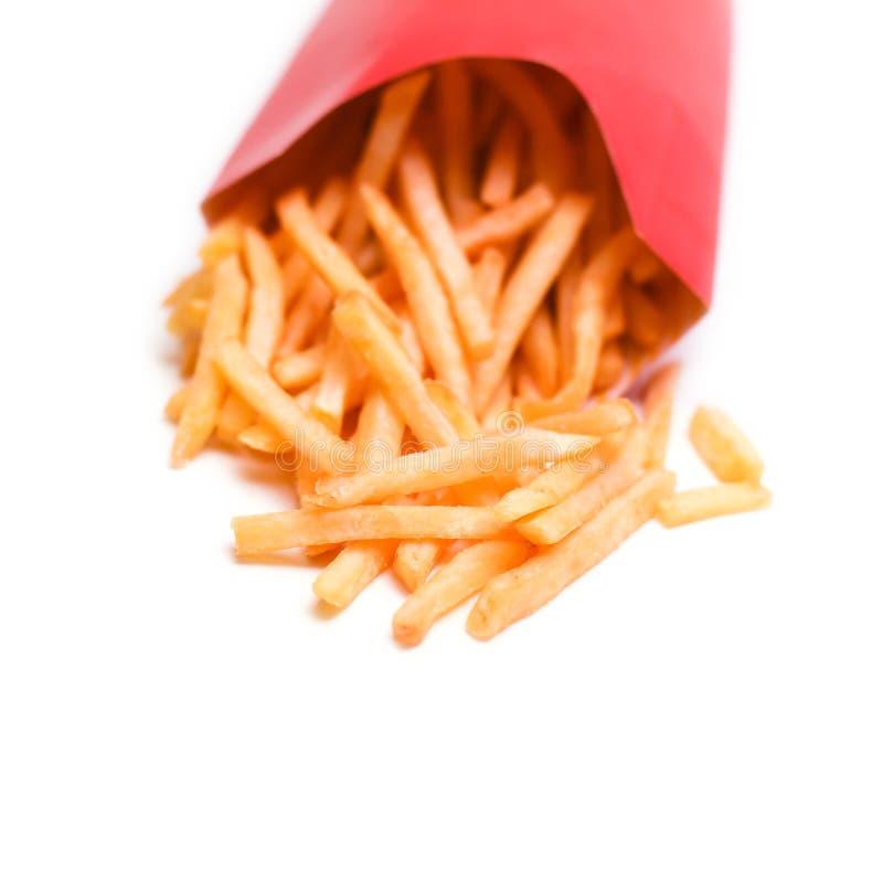 Pommes frites d'isolement sur un fond blanc photographie stock libre de droits