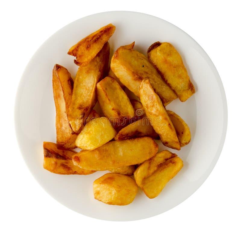 Pommes frites d'une plaque photographie stock