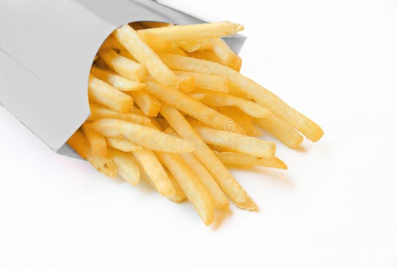 Pommes frites dans le cadre blanc images stock