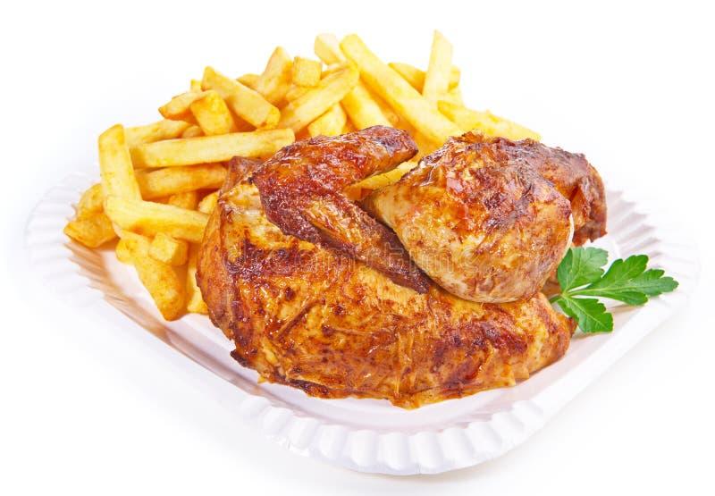Pommes frites grillées de wirh de poulet image libre de droits