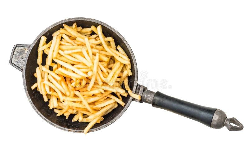 Pommes frites i stekpanna royaltyfri bild