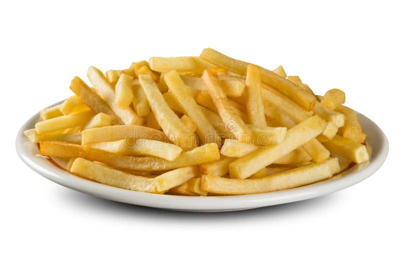 Pommes frites på maträtt royaltyfria foton