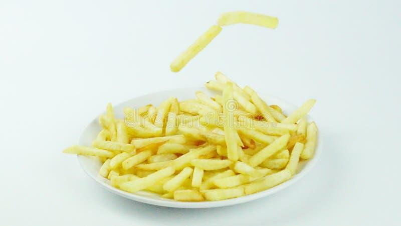 Pommes frites, pommes chips ou puces de doigt image stock
