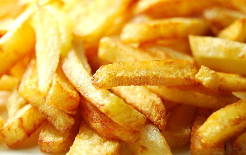 Pommes-Friteshintergrund lizenzfreie stockfotos