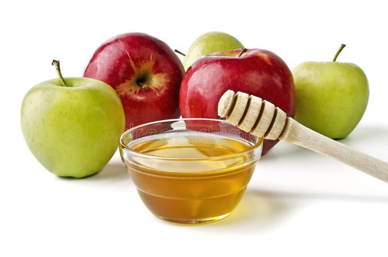Pommes rouges et vertes et un bol de miel image stock