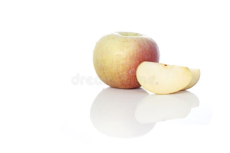 Pommes sur le fond blanc images stock