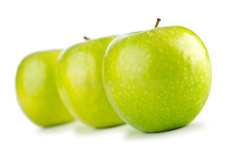 Pommes vertes d'isolement image libre de droits