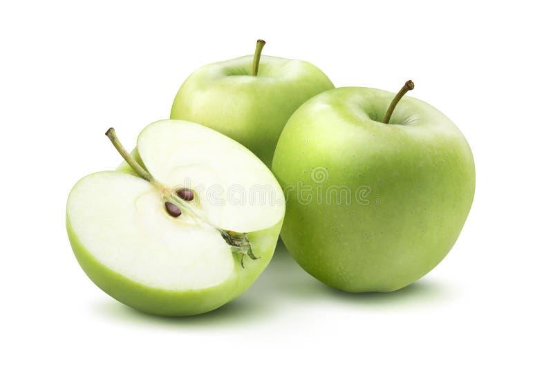 Pommes vertes et moitié d'isolement sur le fond blanc photos stock