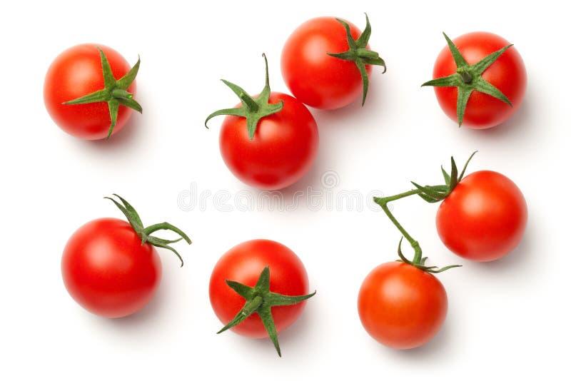Pomodori di ciliegia su priorità bassa bianca immagine stock