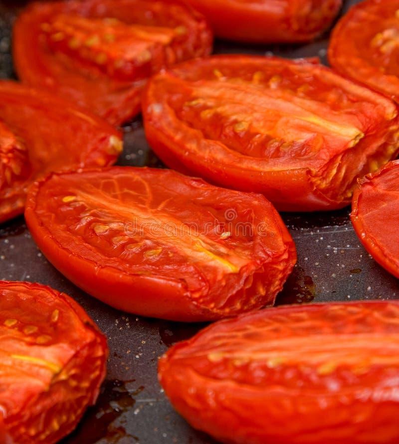 Pomodori di torrefazione fotografie stock