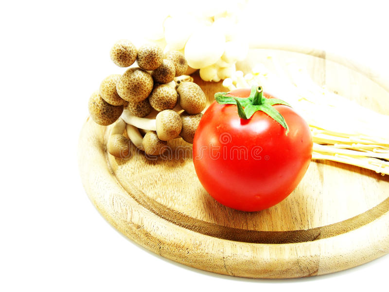 Download Pomodori e fungo fotografia stock. Immagine di vitamina - 55360514