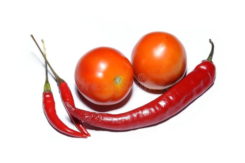Pomodori e peperoncini rossi freschi immagine stock libera da diritti