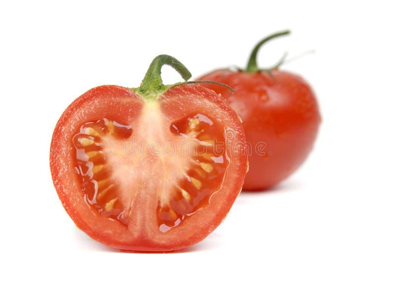 Pomodori freschi su un fondo bianco fotografia stock