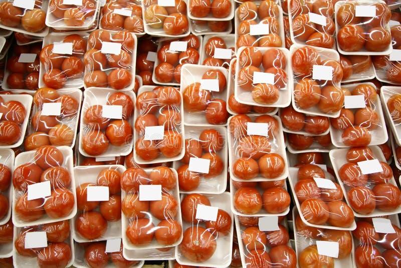 Pomodori imballati fotografia stock