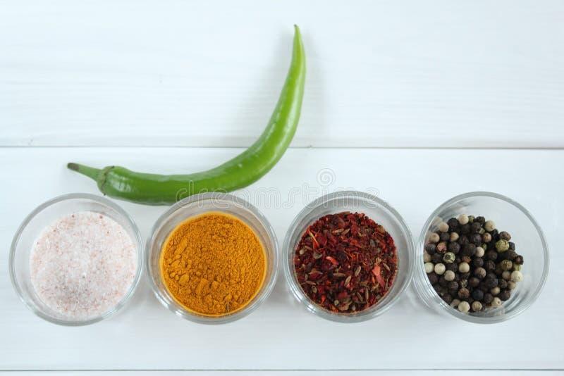 Pomodori secchi pepe del curry del sale fotografia stock