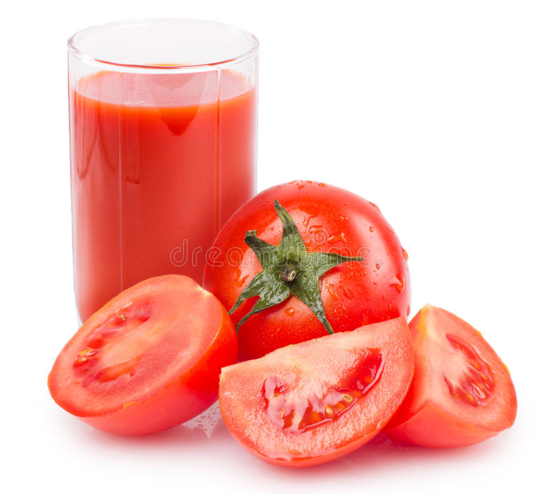 Pomodoro fresco con spremuta fotografie stock