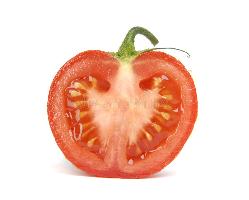 Pomodoro fresco su una priorità bassa bianca fotografie stock