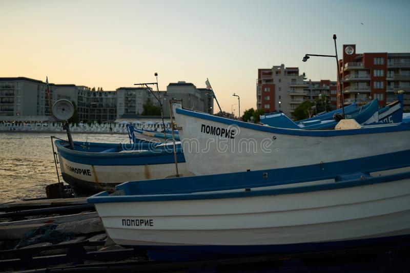 Fishermen`s boats stand on the shore of the seaport of the seaside resort town of Pomorie. POMORIE, BULGARIA - JUNE 30, 2019: Fishermen`s boats stand on the royalty free stock photography
