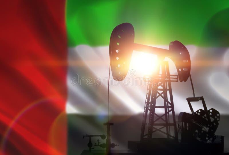 Pompa della trivellazione petrolifera su fondo della bandiera degli emirati fotografie stock