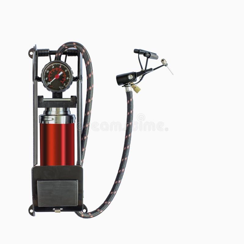 Pompa a pedale con il calibro di pressione d'aria immagini stock