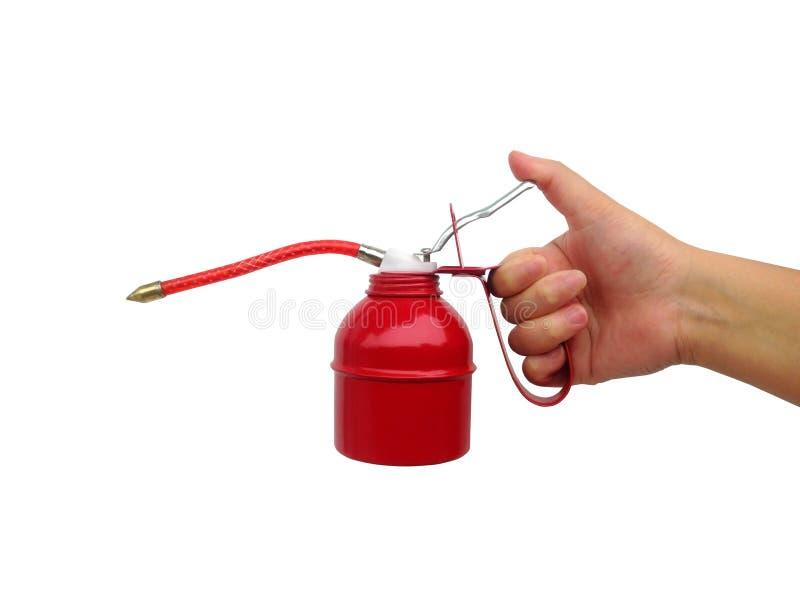 Pompe rouge de graisseur de machine d'isolement sur le fond blanc image stock