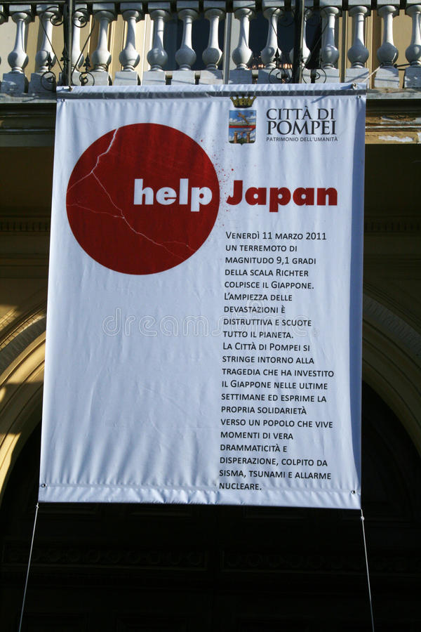 Pompei for japan. A big banner for help japan in front of the town hall of Pompeii in Italy. The banner explains what happened in japan after the big earthquake royalty free stock images