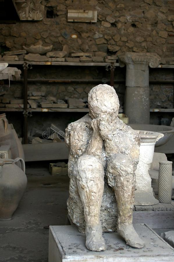 Pompei man with hands covering face. Before death royalty free stock image