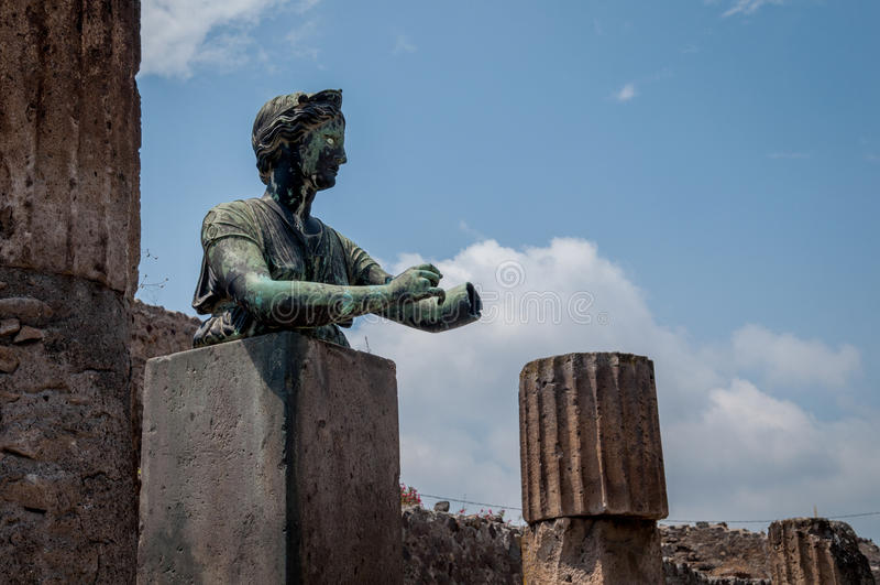 Pompei ruins. Statue in the Pompei Ruins stock image