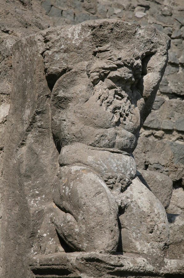 Pompeii. Ancient stone sculpture of the bared person in destroyed Pompeii royalty free stock photo