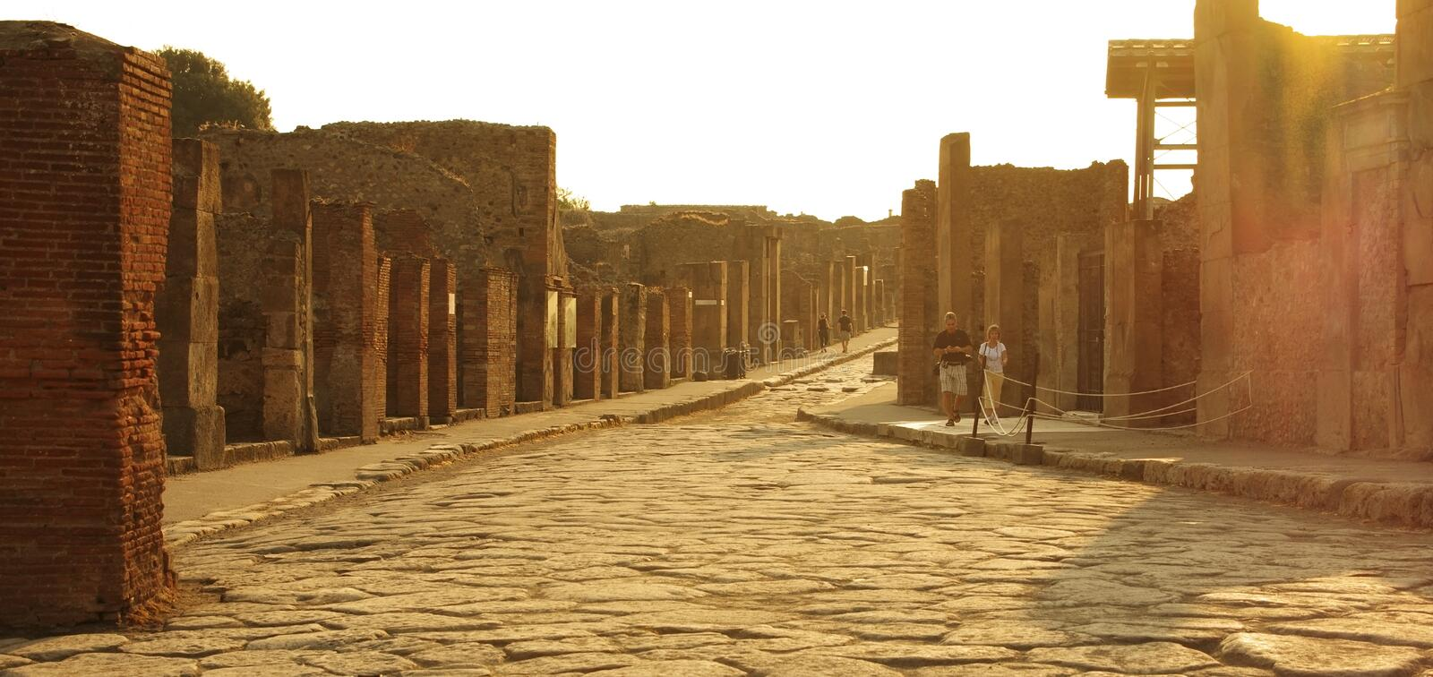 Pompeii. Italy - SEPTEMBER 30: Ruins on sunset on September 30, 2011 in  Italy.Tourists visiting the old roman town of , destroyed by volcanic eruption of Mt royalty free stock images
