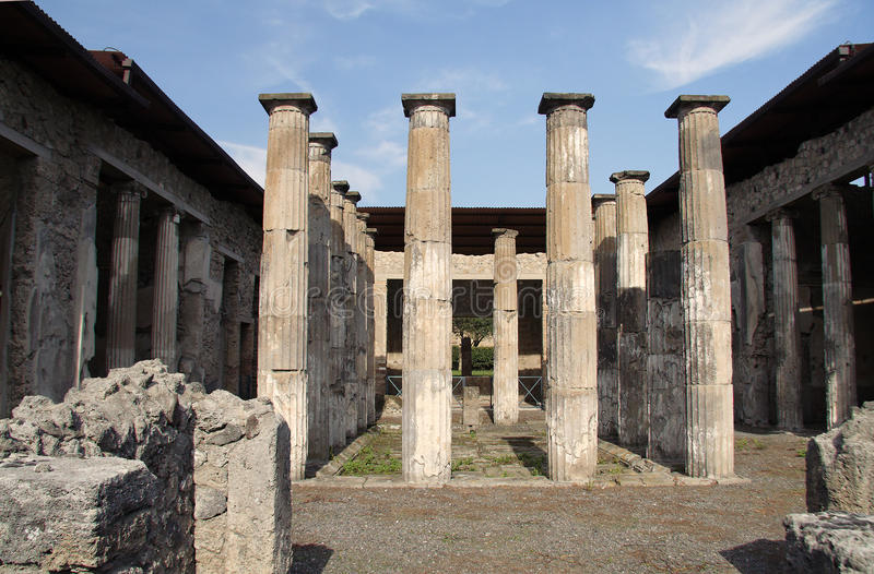 Pompeii Ancient Roman Ruins. A square with ten columns and two walls also sustained by columns in the ruins of the Roman city of Pompeii. Camapania, Italy royalty free stock images