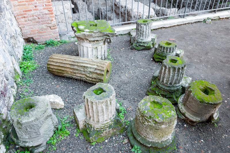 Pompeii, the best preserved archaeological site in the world, Italy. Remains of columns. Pompeii, the archaeological site rich in houses, squares and historical royalty free stock photos