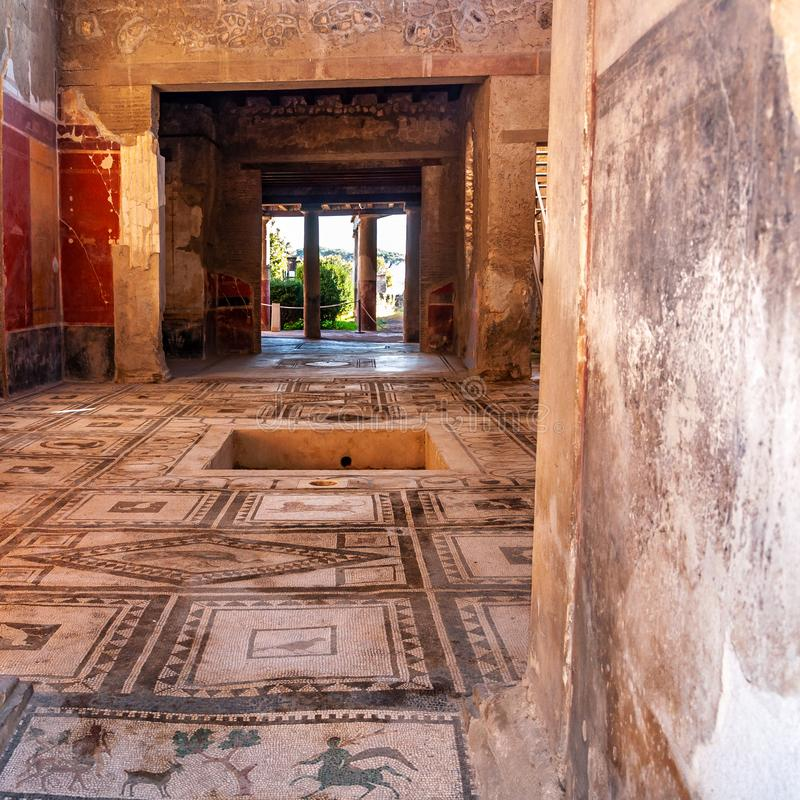 Pompeii, the best preserved archaeological site in the world, Italy. Home interior with garden. Pompeii, the archaeological site rich in houses, squares and stock photo