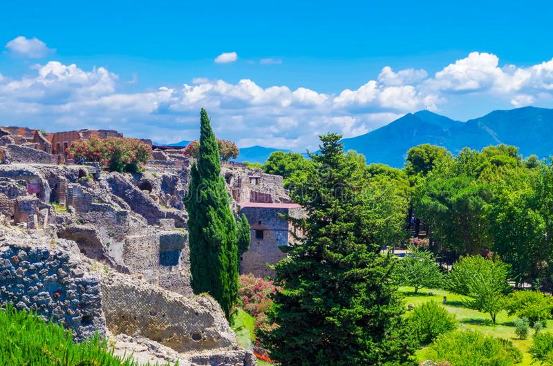 Pompeii, archeological site, Ancient ruins of dying city with mountains on the backside. Pompeii, archeological site: Ancient ruins of city with mountains on royalty free stock photography