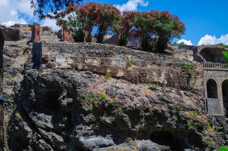 Pompeii, archeological site, ancient ruins of town walls and layers of volcanic lava. Pompeii, archeological site. Ancient ruins of town walls and layers of stock image