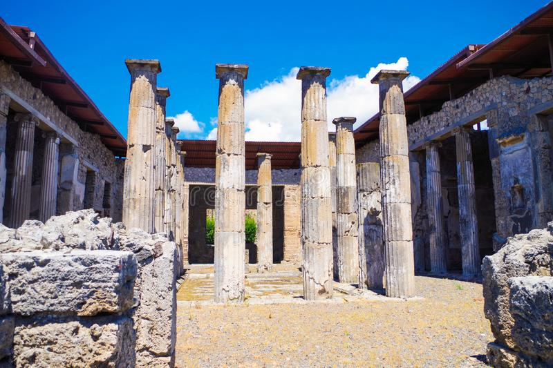 Pompeii, archeological site, ancient ruins of villa with columns. Pompeii, archeological site. Ancient ruins of villa with columns royalty free stock images