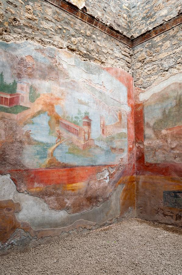 Pompeii, the best preserved archaeological site in the world, Italy. Frescoes on the interior wall at home destroyed. Pompeii, the best preserved archaeological royalty free stock images