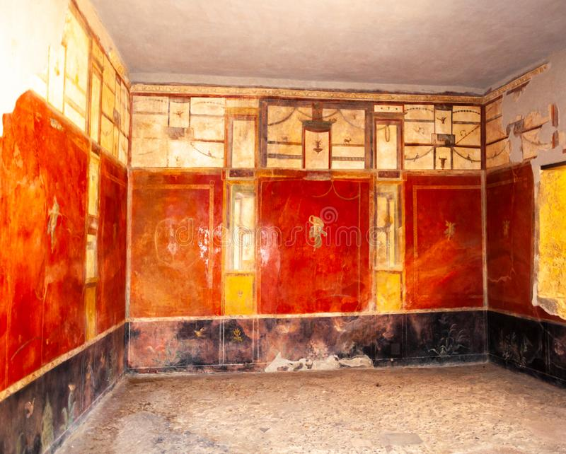 Pompeii, the best preserved archaeological site in the world, Italy. Frescoes on the interior wall at home. Pompeii, the best preserved archaeological site in royalty free stock images