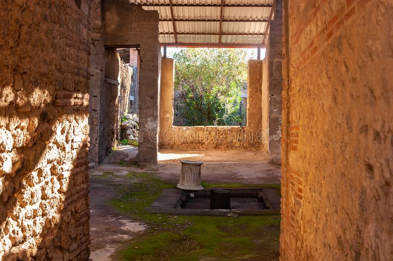 Pompeii, the best preserved archaeological site in the world, Italy. Home interior with garden. Pompeii, the archaeological site rich in houses, squares and stock photos