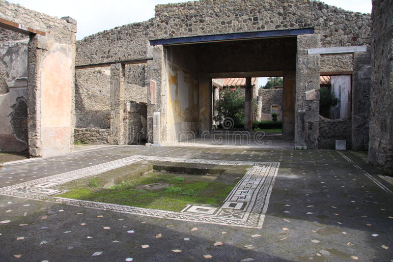 Pompeii. Inside the remains of the Atrium, large reception room of an ancient Roman Villa with the impluvium at the centre, Pompeii, Italy royalty free stock photos